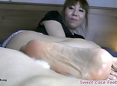 Foo fuckers Heli Angel flexes her ass and gets a solid foot stroking