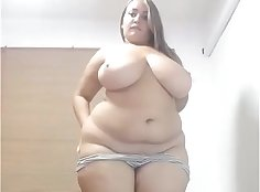 BBW Lauren strips and caresses huge dong