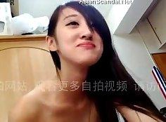 Chinese girlfriend bangs sliding cock