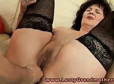 Mature mom in stockings using toys on it when spied