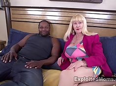 Blonde mature hooker with big tits is giving a strong blowjob